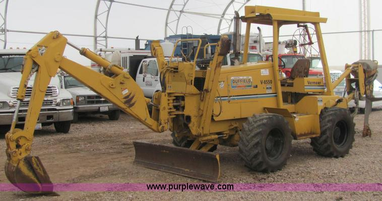 C3064.JPG - 1995 Vermeer V8550 backhoe/vibrating plow , 1,446 hours on meter , Cummins 3 9L four cylinder diesel...