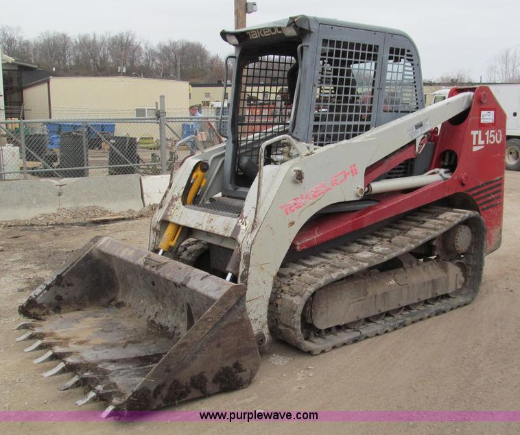 E5854.JPG - 2005 Takeuchi TL150 track skid steer , 5,711 hours on meter , Yanmar four cylinder turbo diesel engi...