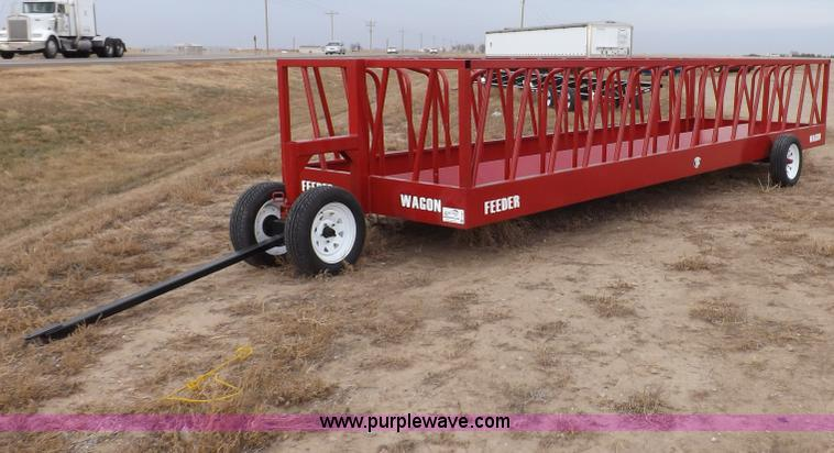 F6363.JPG - Feeder wagon , 24L x 81 quot W body , 88 quot front axle and tongue assembly , 15 head stalls per si...