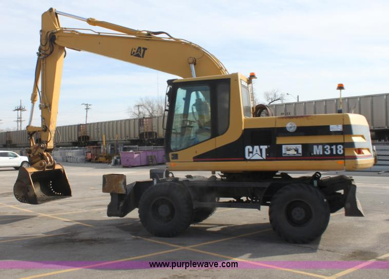 E8349.JPG - 1998 Caterpillar M318 mobile excavator , 6,041 hours on meter , Caterpillar 3116T diesel engine , 14...