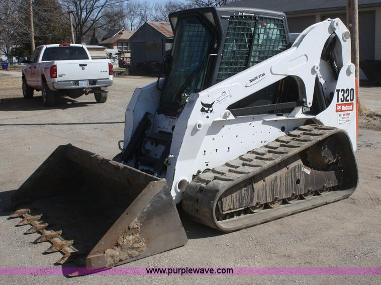 F2571.JPG - 2010 Bobcat T320 compact track skid steer , 2,385 hours on meter , Hours may vary , Four cylinder tu...