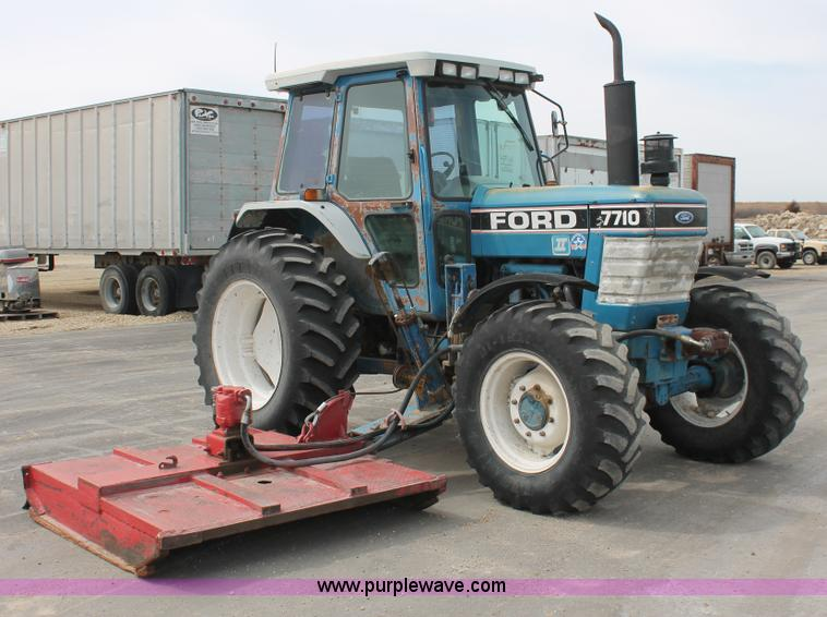 F2943.JPG - 1991 Ford 7710 MFWD tractor , 7,563 hours on meter , Ford four cylinder diesel engine , Serial 28547...