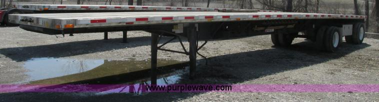 F4492.JPG - 2008 Transcraft 48 spread axle flat bed trailer , 102 quot W , Aluminum deck , Front and side stake ...