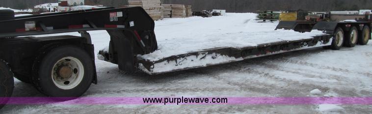 G2575.JPG - 1996 Etnyre triple axle lowboy trailer , Model PRTN50T03 T1 , 24 well , 102 quot W , Wood deck , Out...