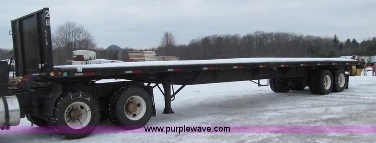 G2576.JPG - 1993 Utility flatbed trailer , 48L x 97 quot W wood deck , Stake pockets , Headache rack , Ratchet t...