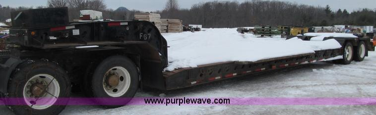 G2577.JPG - 2001 X L 80HDG tandem axle lowboy trailer , 26 well , 102 quot W , Wood deck , Outriggers , Honda ga...