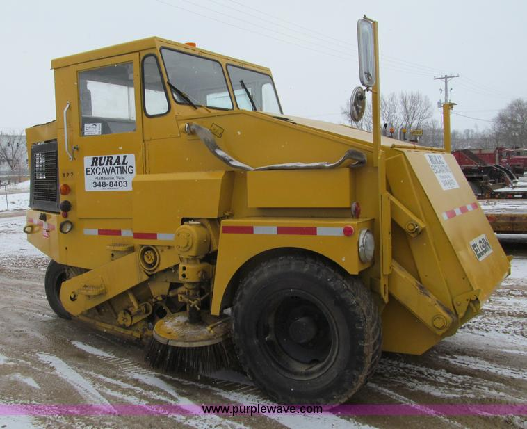 F5957.JPG - Elgin 977 street sweeper , Four cylinder diesel engine , Four speed transmission , Right side operat...