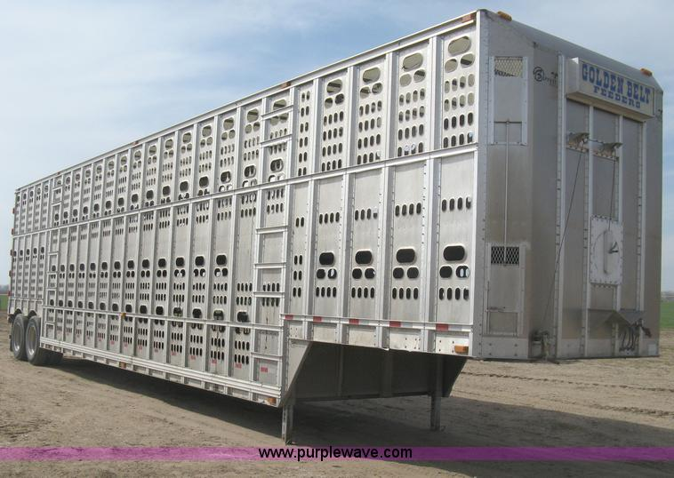 E3357.JPG - 2010 Barrett cattle pot trailer , 51L x 102 quot W , Aluminum construction , Punch side , Two post l...