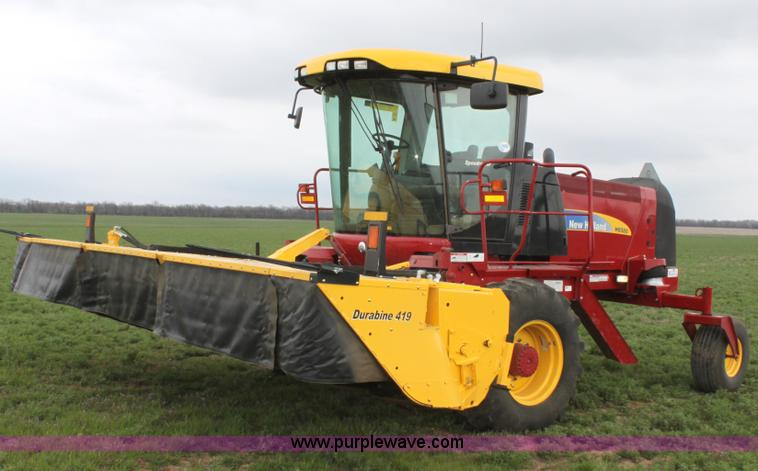 F8710.JPG - 2012 New Holland H8080 self propelled swather , 192 hours on meter , Six cylinder diesel engine , 22...