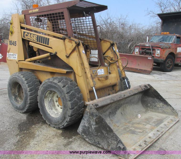 E7145.JPG - 1995 Case 1845C skid steer , 7,009 hours on meter , Cummins 4BT diesel engine , OROPS , 72 quot W bu...