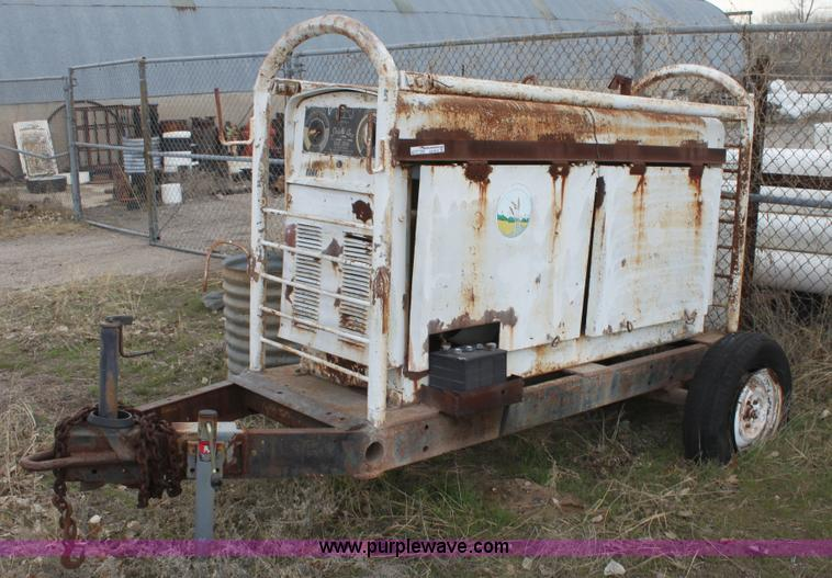 AA9072.JPG - Lincoln Electric SAE300 arc welder , Six cylinder gas engine , 40V , Pintle hitch , 15 quot tires , ...