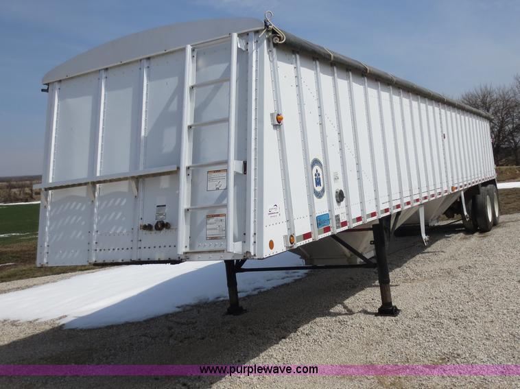 D5811.JPG - 2002 Merritt 42 double hopper grain trailer , 68 quot sides , Shur Lok rollover tarp , Spring suspen...