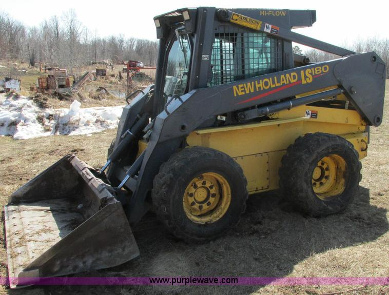 E5062.JPG - New Holland LS180 skid steer , 5,431 hours on meter , Hours may vary, still in use , New Holland 334...