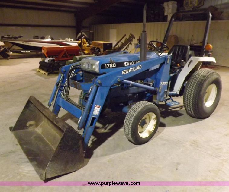 H7214.JPG - New Holland 1720SSS MFWD tractor , 2,303 hours on meter , 1 49L three cylinder diesel engine , 26 4 ...