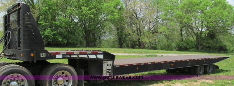 F5064.JPG - 1996 Landoll 660 48 trailer , 38 flat , 102 quot W , Steel deck , Dock leveling system , Tie downs ,...