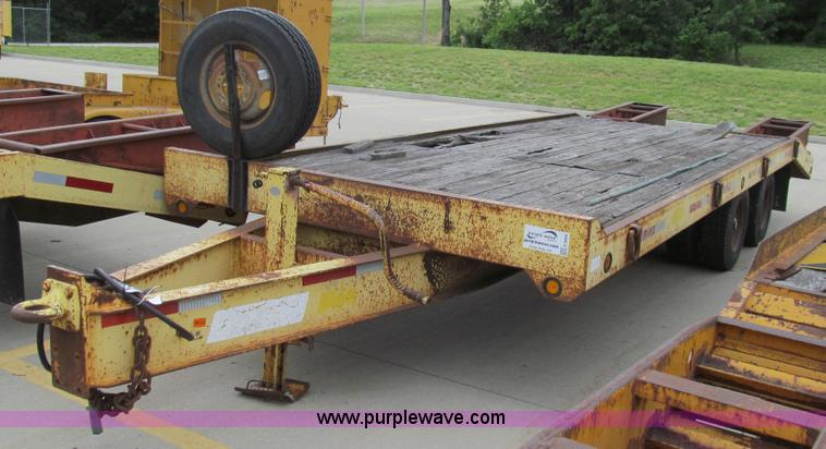 E3964.JPG - 1997 Towmaster trailer , 19L x 95 quot W , 5 steel beaver tail , 5 fold down ramps , Wood floor on m...