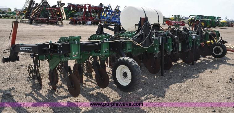 G6035.JPG - Schlagel SC2009 strip till , 12 rows , 30 quot spacing , Folding bar , Hydraulic fold back marker br...