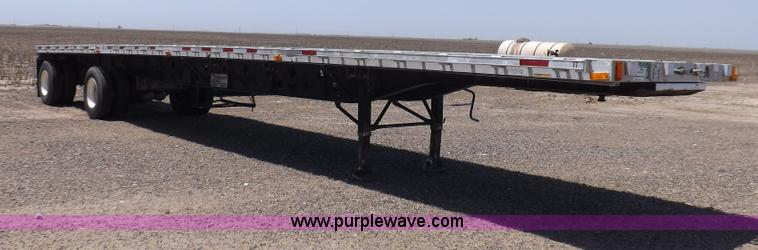 H7009.JPG - 1995 Transcraft flatbed trailer , 48L x 96 quot W , Dual leg two speed landing gear , 12 4 quot ratc...