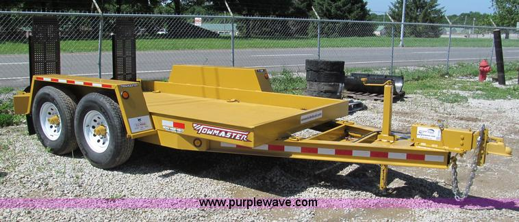 F5104.JPG - 2011 Towmaster T10P skid steer trailer , 12L x 77 quot W , Steel construction , 2 46 quot L x 16 quo...