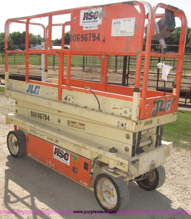 F7105.JPG - 1997 JLG 2033E scissor lift , 983 hours on meter , Front wheel drive and steer , 750 lbs max capacit...