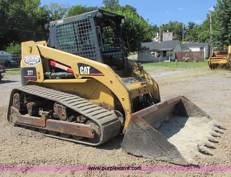 E7355.JPG - Caterpillar 277 track skid steer , 2,782 hours on meter , Perkins four cylinder diesel engine , Encl...