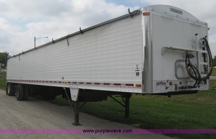 H6312.JPG - 2008 Wilson DWBT 600 belt trailer , 49L x 8W , 64 quot H side wall , V bottom style , 48 quot W hydr...