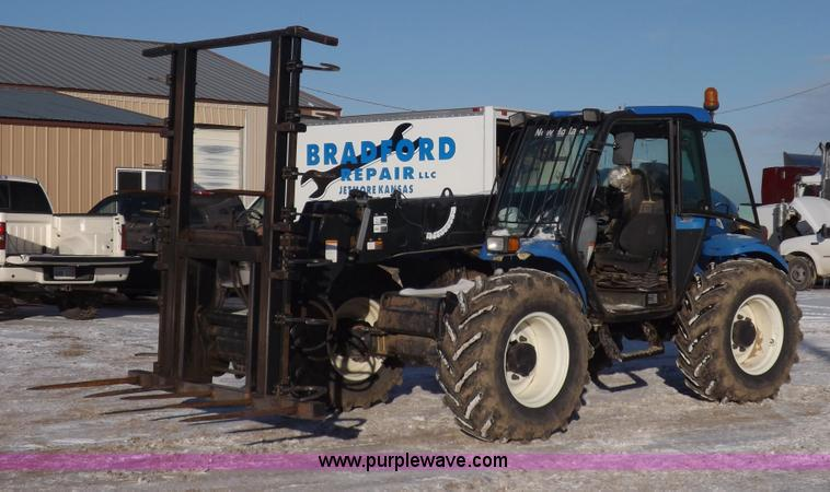 I9239.JPG - New Holland LM435A telehandler , 2,052 hours on meter , Four cylinder diesel engine , Model 113154 ,...