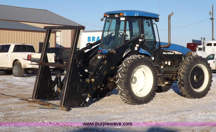 I9240.JPG - 2005 New Holland TV145 MFWD bi directional tractor , 1,661 hours on meter , Six cylinder diesel engi...