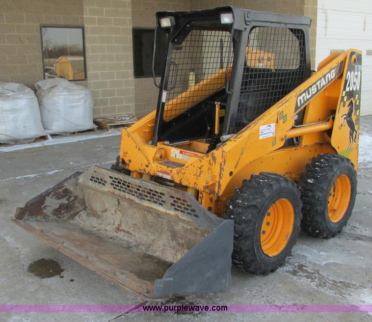 E5233.JPG - Mustang 2050 skid steer , 3,313 hours on meter , Yanmar diesel engine , 49 HP , Serial 53442 , OROPS...