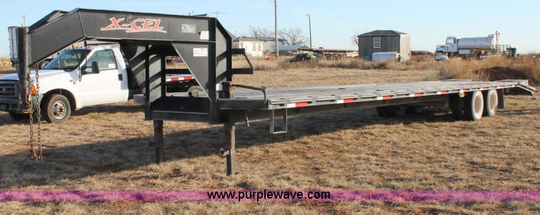 C3685.JPG - 2006 XCEL gooseneck trailer , 35L wood deck , 5L dovetail , 4 5L fold down ramps , Front mounted win...