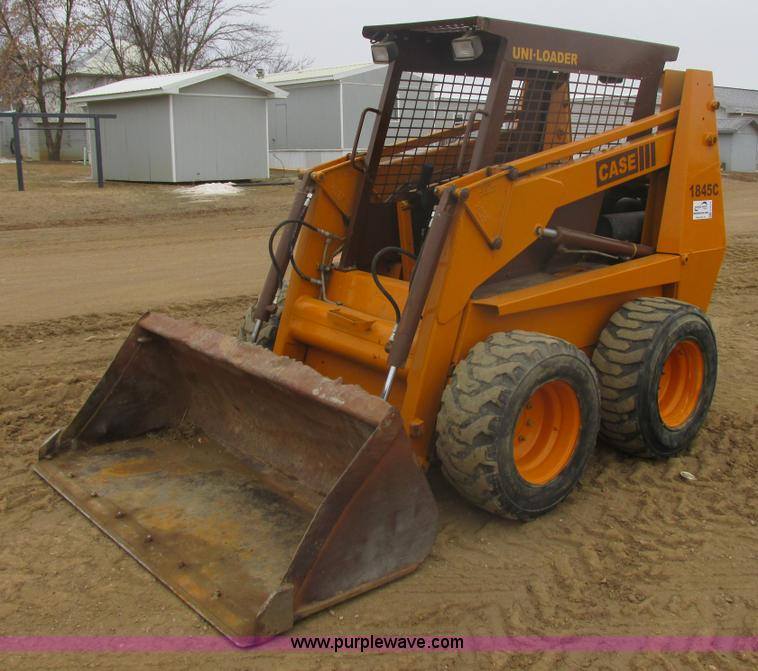E5274.JPG - 1994 Case 1845C skid steer , 1,335 hours on meter , Case 4 290 239 C I D four cylinder diesel engine...