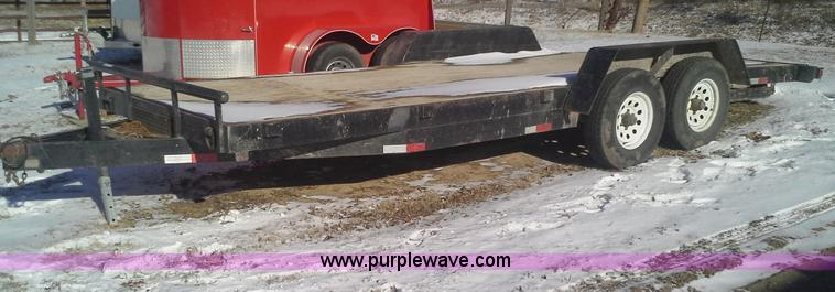 AN9133.JPG - 1995 Loadmaster utility trailer , 20L x 82 quot W wood deck , Chain basket , Chains are not included...