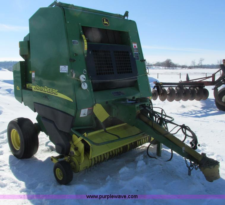 G8834.JPG - 2004 John Deere 582 silage special round baler , 540 PTO , Surface wrap , Twine tie , 5 bale capacit...