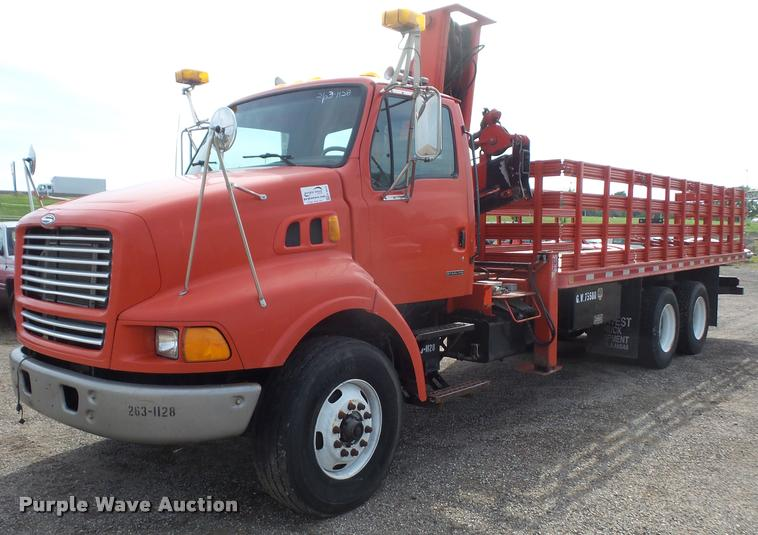 1999 Sterling L9000 flatbed truck with crane