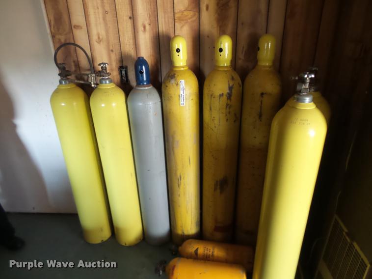 (8) oxygen bottles