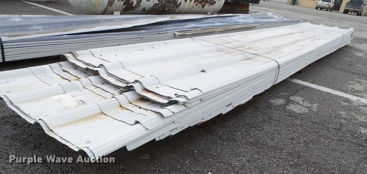 Approximately 35 pieces of metal sheeting