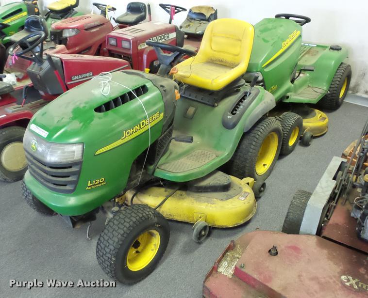 (3) John Deere lawn mowers