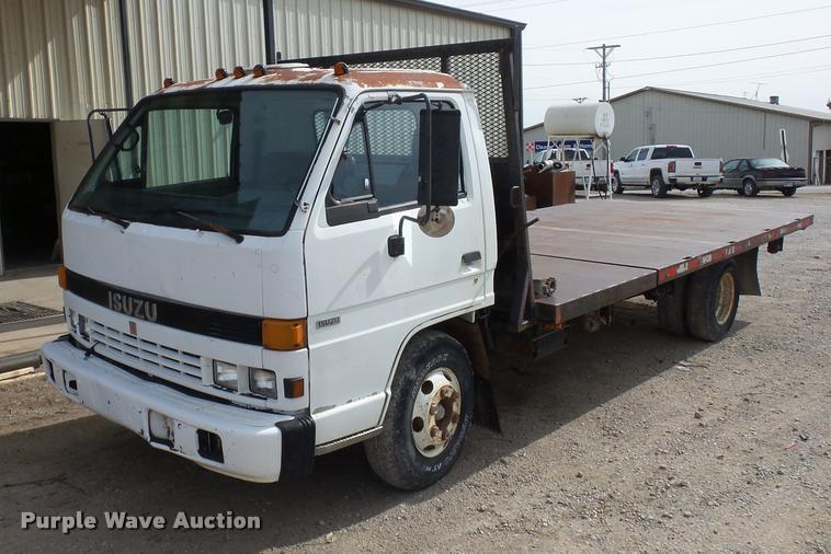1992 Isuzu NPR flatbed truck