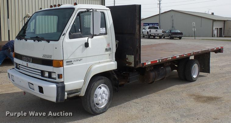 1994 Isuzu NRR flatbed truck