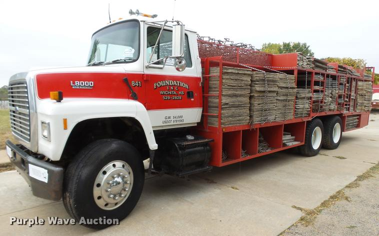 1992 Ford LNT8000 flatbed truck with concrete forms