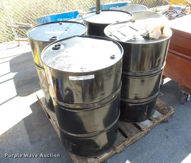 (11) 55 gallon drums