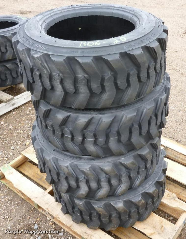 (4) 10x16.5 skid steer tires