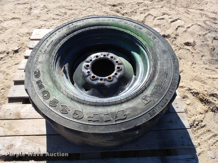 Firestone 10-16.5 skid steer tire and wheel
