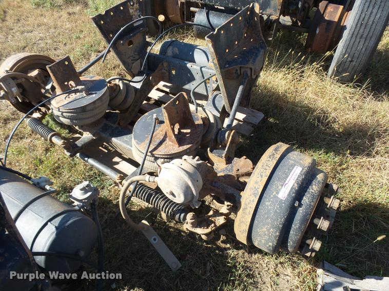 Pusher axle