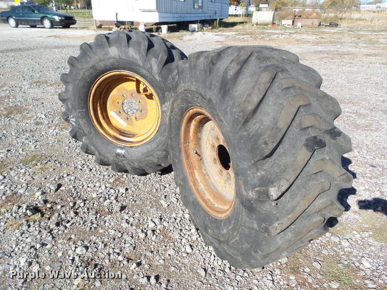 (2) Bridgestone 17.5/65-20 tires