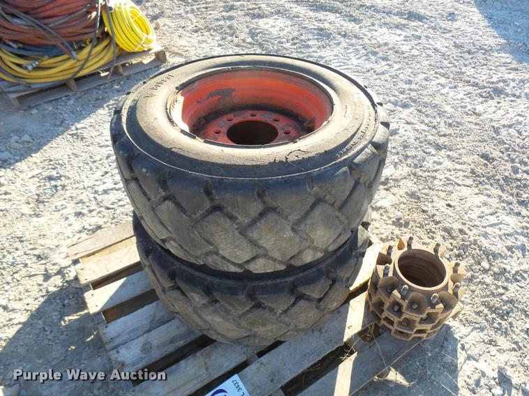 (2) 12-16.5 skid steer tires and wheels