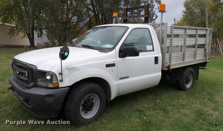 2004 Ford F250 Super Duty flatbed pickup truck