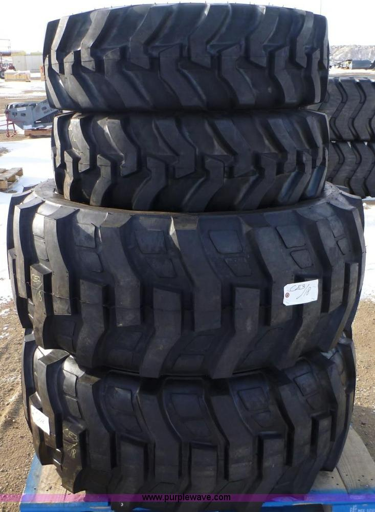 (4) Marcher backhoe tires