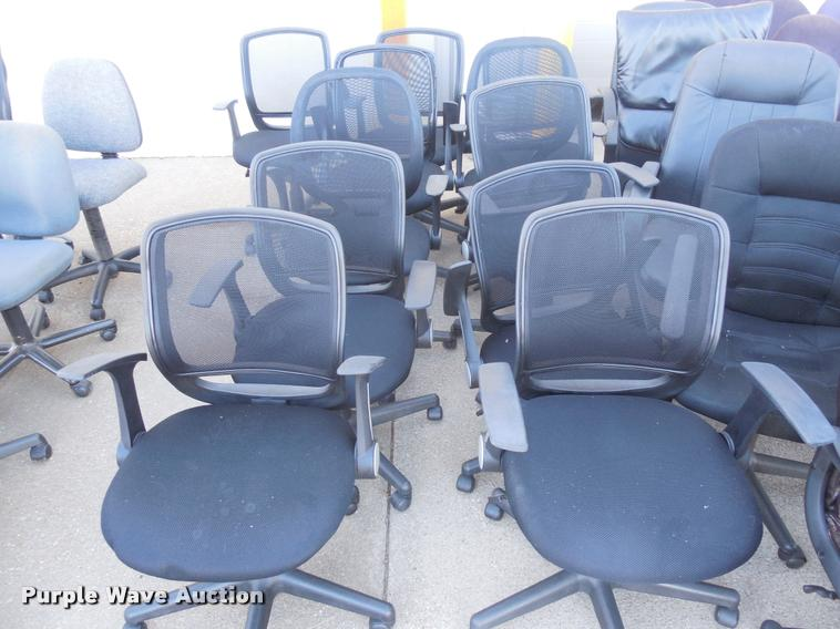 Approximately 30 office chairs