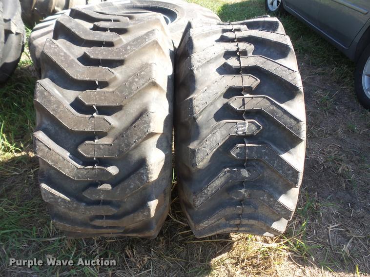 (2) Firestone 15-19.5 NHS tires